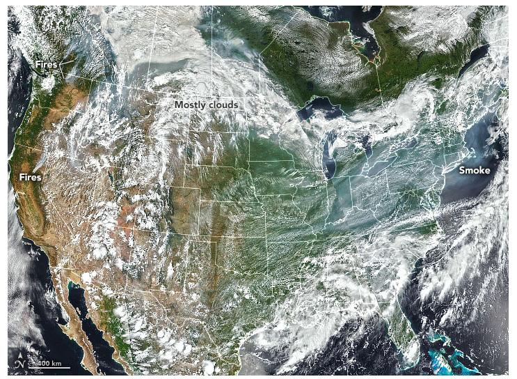 A visible satellite image of the middle latitudes on the northern western hemisphere on July 20, 2021. Smoke from western forest fires can be seen among clouds near the US-Canadian border in the west and dominates the sky over the Midwest in the Mid-Atlantic states.